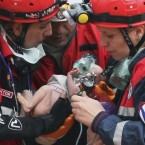 A two-week-old baby is rescued from under the debris of a collapsed building on 25 October following the 7.2-mag earthquake in eastern Turkey. Her mother also survived the quake. Over 600 people were killed. (AP/PA Images)