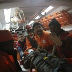 Turkish rescuers pulled a 13-year-old boy alive from the rubble of a collapsed building 108 hours after a major earthquake hit eastern Turkey in October, 2011. (AP Photo/PA Images)