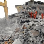 Rescue workers remove rubble at the site of a collapsed building, three days after a magnitude 7.2 earthquake jolted the area in Ercis, eastern Turkey, on 26 October, 2011. (The Yomiuri Shimbun/AP Photo/PA Images)