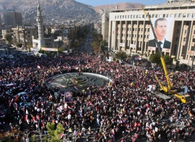 Crowds gather in Damascus for a rally in support of President Assad on 2 December.