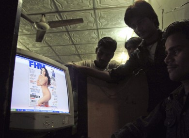 Pakistanis look at a website displaying Veena Malik's photo on the website of FHM India, at an Internet cafe in Karachi, Pakistan