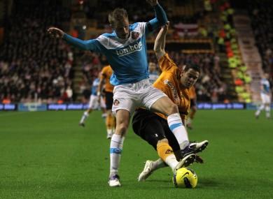 Sunderland's Sebastian Larsson buckles under a challenge from Matt Jarvis.