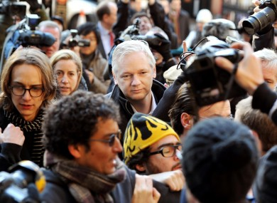 Assange arrives at the Royal Courts of Justice, in central London this morning