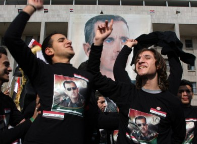 Assad supporters gathered in Damascus on Friday.