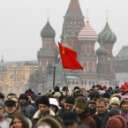 Protesters wave a red flag, a symbol of revolution (AP Photo/Alexander Zemlianichenko)