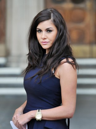 Imogen Thomas poses outside the Royal Courts of Justice in London, after representatives for Ryan Giggs withdrew allegations of blackmail against her.