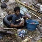 A resident rummages through the debris in Cagayan De Oro. (AP Photo/Froilan Gallardo)