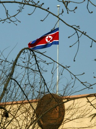 The North Korean flag flies at half-mast over its embassy in Beijing, China.
