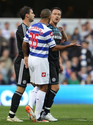 Anton Ferdinand argues with John Terry at Loftus Road.