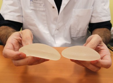 French doctor Maurice Mimoun, a plastic surgeon, holds silicone gel breast implants made by French company Poly Implant Prothese, or PIP, that he removed from a patient because of concerns that they are unsafe.