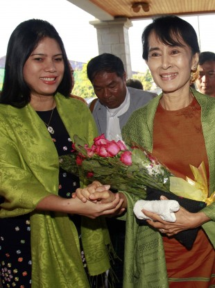 Aung San Suu Kyi, right, pictured yesterday before she officially registered her political party.