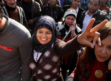 Samira Ibrahim, 25, flashes the victory sign during a rally supporting women's rights in Cairo, Egypt, today. Ibrahim filed a lawsuit  against virginity tests after being subjected to a forced 'test'.