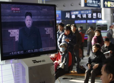 Travellers at Seoul train station watch footage of North Korea's next leader Kim Jong Un yesterday