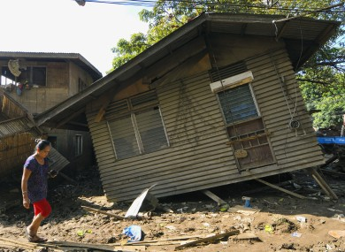 A house destroyed by flash floods caused by tropical storm Washi two weeks ago in Cagayan de Oro on the Philippines' Mindanao island