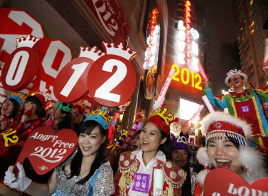 Revellers smile during the New Year celebrations in Hong Kong's Times Square Sunday, 1 January, 2012