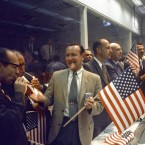 NASA and Manned Spacecraft Centre officials join flight controllers in their post-mission celebrations. (NASA)