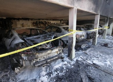The charred remains of cars in LA yesterday.