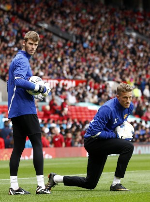 The two players warming up at Old Trafford.