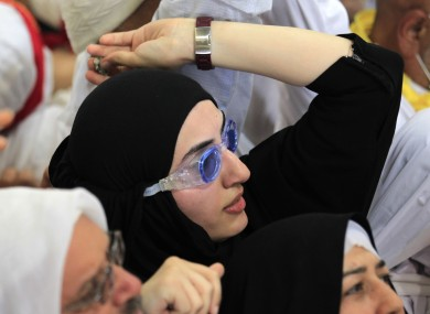 A Saudi Arabian woman wears goggles at a stone-throwing ceremony in November. From today, it is illegal for any man to work in a lingerie store in the country.
