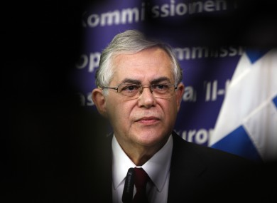Lucas Papademos's government will have to leave the euro if it cannot finalise a deal on writing off some debts, a spokesman says.