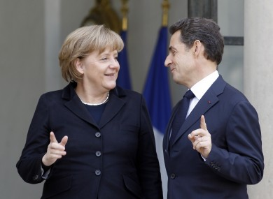 Who's number one? Merkel and Sarkozy pictured in December