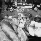 Tom Crean and Edgar Evans mending sleeping bags. (Topham Picturepoint/PA Images)