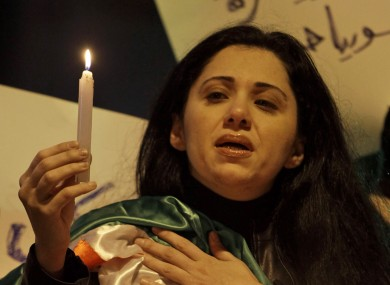A Syrian woman at a candelight vigil in memory of those killed in the uprising, in Beirut, Lebanon.