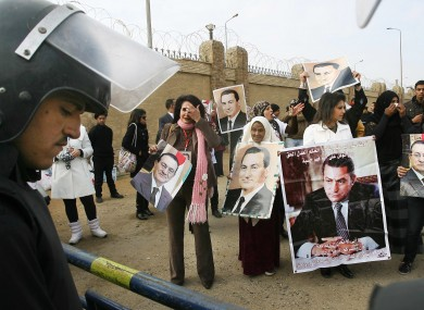Supporters of former Egyptian leader Hosni Mubarak hold a rally outside a Cairo courthouse where Mubarak's trial resumed today.