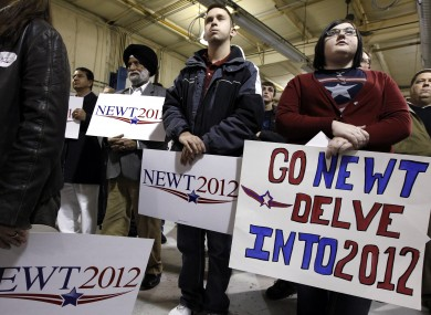 Supporters of Newt Gingrich gather at his Iowa campaign headquarters yesterday