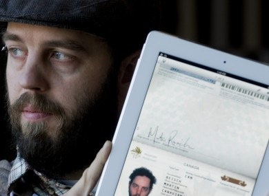 Martin Reisch with the scan of his passport on his iPad which he used to enter the US from Canada.
