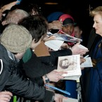 Meryl Streep signs autographs for fans.