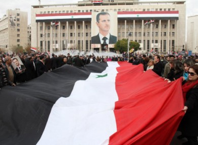 Syrian government supporters at a rally in Damascus, Syria yesterday.