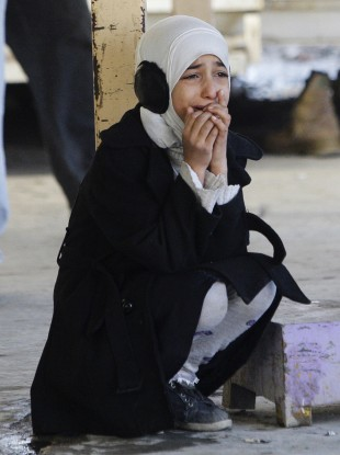 Waves of sectarian violence have recently left dozens dead in Iraq. Picture: Hana Abbas Lazim, 11, cries for her father who was killed in a bomb attack in Sadr City last Thursday, 5 Jan.