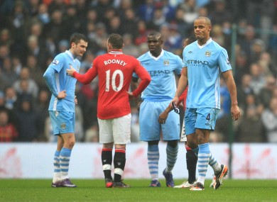 Vincent Kompany heads down the tunnel after he was sent off for dangerous play in yesterday's FA Cup third round match between Manchester City and Manchester United.