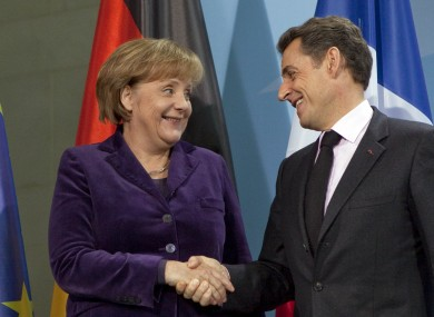 Merkel and Sarkozy at a press conference earlier this month