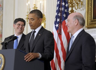 Jacob Lew (left) smiles over at Bill Daley (right), as Barack Obama announces Daley's retirement as Chief of Staff.