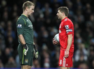 Steven Gerrard eyeballs Joe Hart before taking a penalty last night.