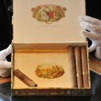 A box containing some of Winston Churchill's Cuban cigars, including one part smoked.