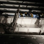 Italian firefighters climb on the luxury cruise ship after it ran aground the tiny Tuscan island of Giglio, Italy early on Saturday. (AP Photo/Gregorio Borgia/PA Images)