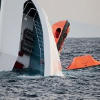 A rescue dinghy hangs from the side of the Costa Concordia. (AP Photo/Gregorio Borgia/PA Images)