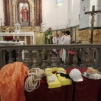 A rope, a lifevest, a helmet and other recovered items are seen in front of the altar during a mass in the tiny Tuscan island of Giglio on Sunday. (AP Photo/Gregorio Borgia/PA Images)