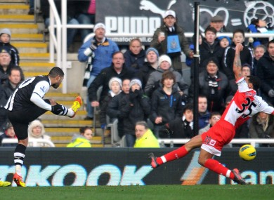 Leon Best sweeps a shot into the right corner of the QPR goal.
