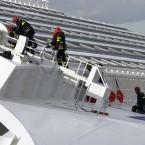 Firefighters work on the luxury cruise ship Costa Concordia. (AP Photo/Andrea Sinibaldi, Lapresse/PA Images)