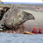A rock is seen protruding from the side of the Costa Concordia the day after it ran aground off the Tuscan island of Giglio. (AP Photo/Andrea Sinibaldi, Lapresse/PA Images)