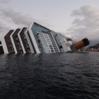 The cruise ship Costa Concordia after it ran aground off the tiny Tuscan island of Giglio on Sunday. (AP Photo/Gregorio Borgia/PA Images)