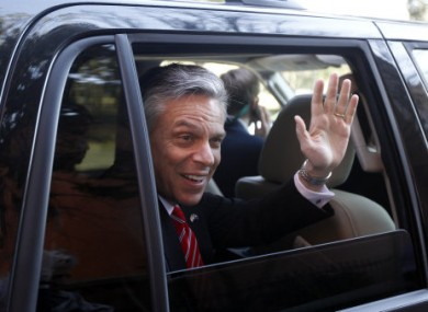 Jon Huntsman waves to supporters in South Carolina yesterday.