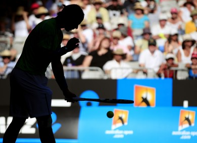 Rafael Nadal prepares to serve in the late afternoon light during his first round match against and Alex Kuznetsov.