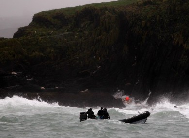 Naval Divers off Adam Island in west Cork, as the search continues for five people who went missing on Sunday.