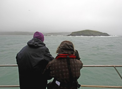 Michael Hayes' wife Caitlín Ní Aodha and daughter Dervla look out to where the Tit Bonhomme lies off west Cork.