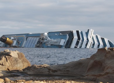 The cruise ship Costa Concordia leans on its side off the tiny Tuscan island of Giglio, Italy, Wednesday, Jan. 18, 2012.
